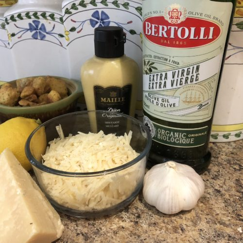 Fresh whole lemon, head of garlic, olive oil, fresh parmegiano reggiano, Digon Mustard