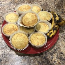 Perfect Banana Muffins on a red plate with whole ripe bananas
