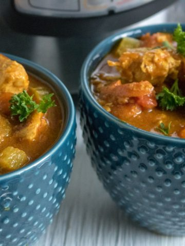 Instant Pot Chicken Curry served in two blue bowls