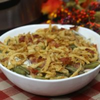 Green Bean Casserole with cooked back and french onions in a white bowl