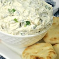 Creamy white dip with cream cheese,, artichokes and jalapeno
