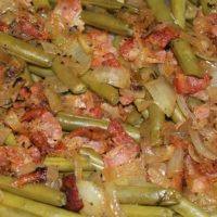 Cooked fresh green beans with bacon and onions