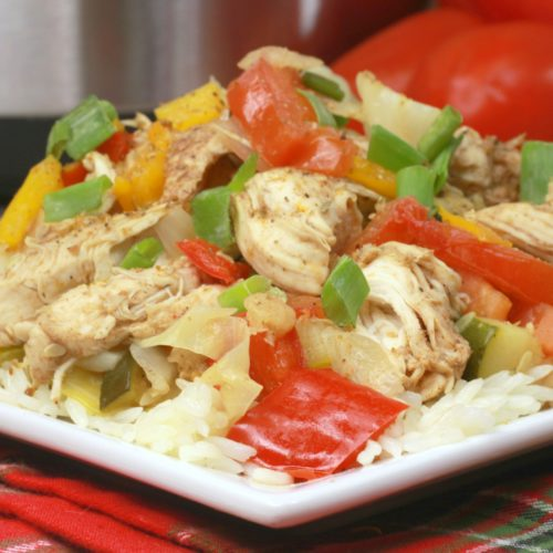 Jerk Chicken with red peppers over rice.