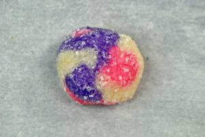 Pink, Purple and white Marbled Cookie Dough rolled in sanding sugar