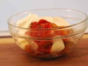 Peel shrimp, greek qyogurt and tandoori seasoning in a glass bowl
