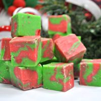 Red and Green White chocolate fudge cut into cubes and piled high.