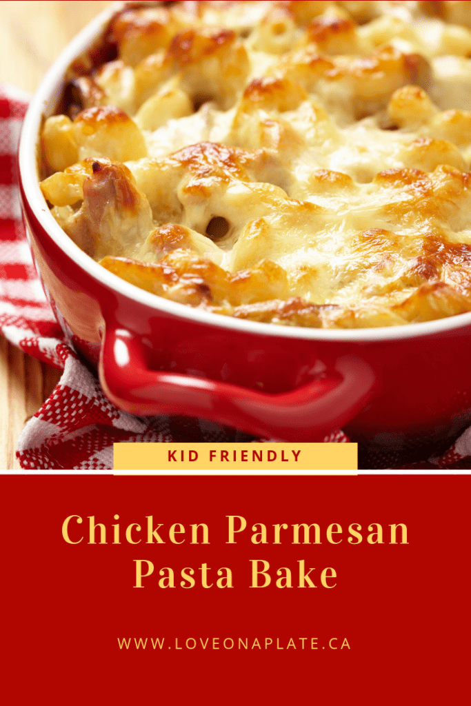 Penne Noodles, tomato sauce, chicken and melted cheese in a red enamel baking dish