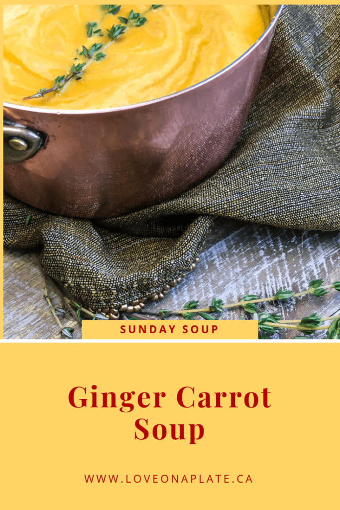 Pureed Carrot soup in a copper pot close up