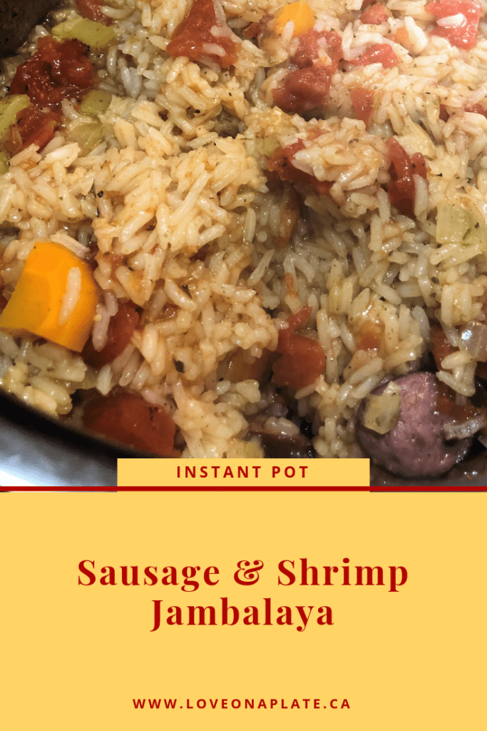 Cooked rice, celery and sausage close up.