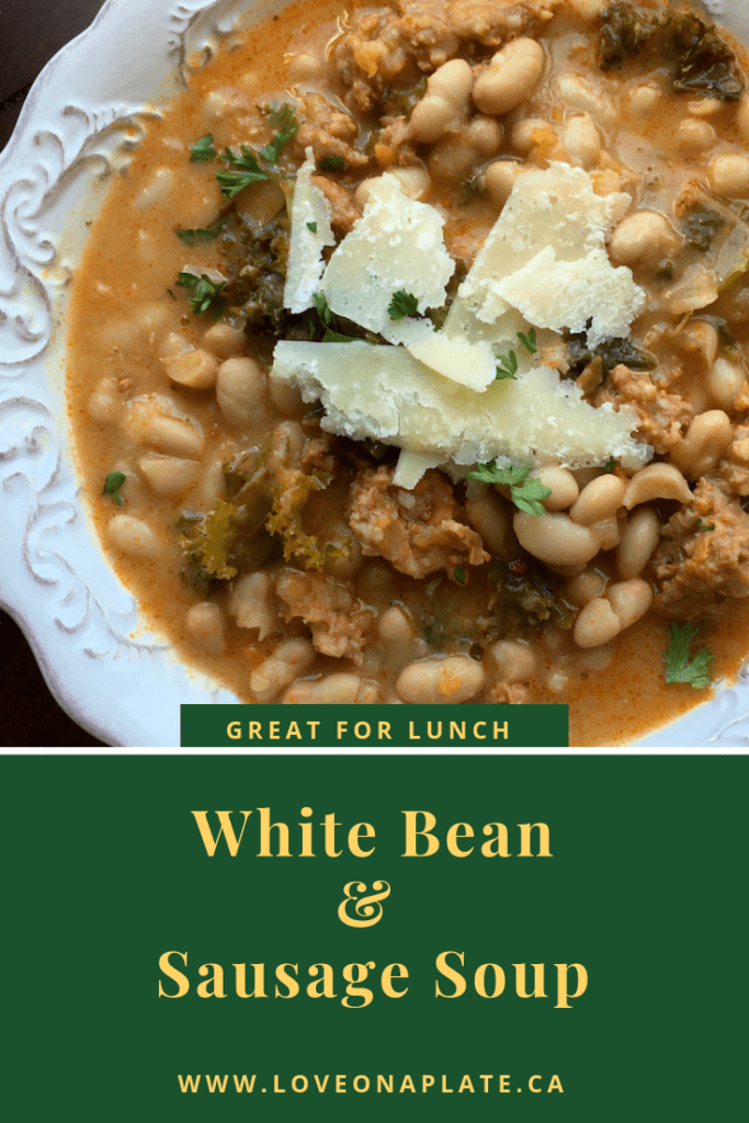 White Bean & Sausage Soup with shaved Parmesan cheese on top