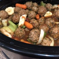 Meatball Stew; Meatballs, baby carrots, sliced celery, Sliced parsnips in sauce in the slow cooker