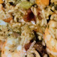 Cooked Jambalaya close up; rice, shrimp, celery, in a cajun broth