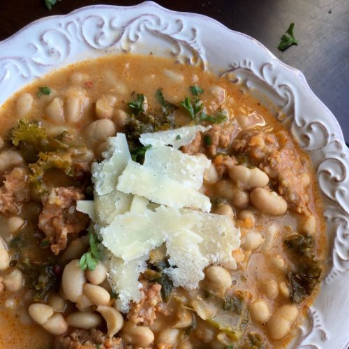 White Bean and Spicy Sausage Soup in a white bowl