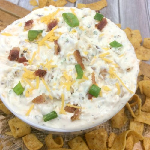 Cream Cheese, Bacon, Shredded Cheddar cheese, flavoured with ranch seasoning and beer in a white bowl.