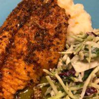 Pan Fried Catfish with cajun seasoning with mashed potatoes and broccoli slaw