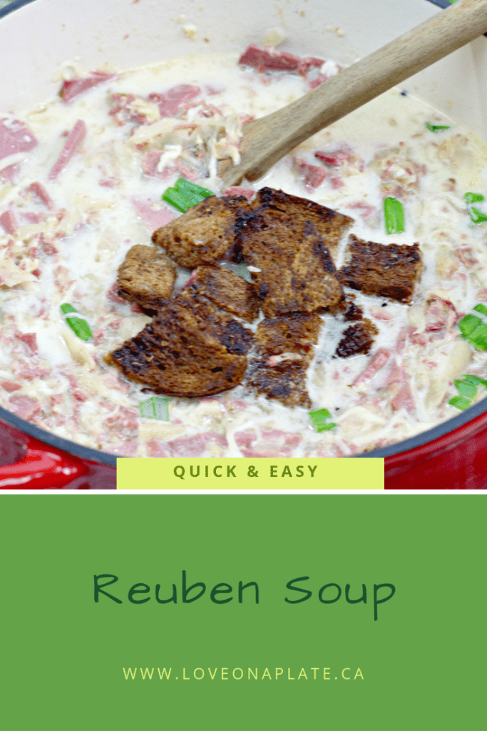 Creamy soup garnished with rye bread croutons and chopped green onions