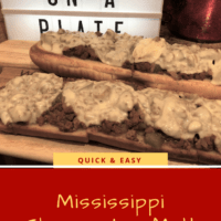 Love on a Plate Sign and Wooden cutting board with Ground Beef and Gravy smothered in cheese
