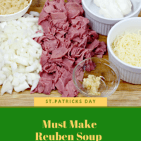 Ingredients for Reuben soup on a wooden board. Corned beef, onions, Swiss Cheese