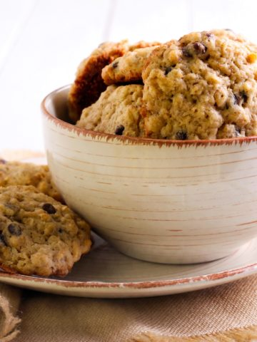 Banana Chocolate Oat Cookies stacked in a white bowl.