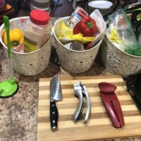 Prepaheadable Meal Prep tools; cutting board, can opener, knife, baskets of food
