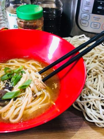 Red Laquered Ramen Bowl with Red Curry Ramen, and chopsticks