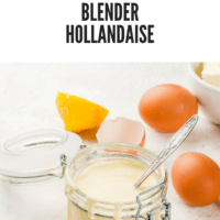 Hollandaise sauce in glass jar, with ingredients for cooking - eggs, butter, lemons. On a white concrete stone table.