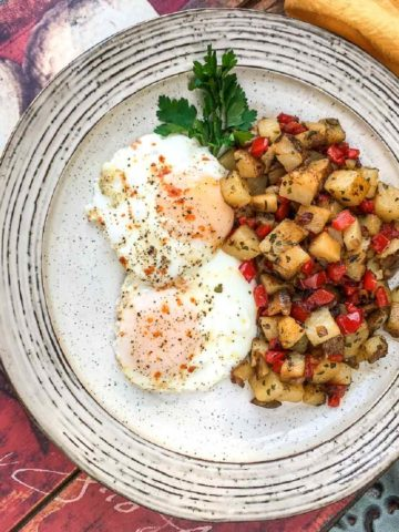 Fried eggs over easy with Parmesan Potato hash with red peppers