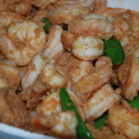 Shrimp with snow pea salad.