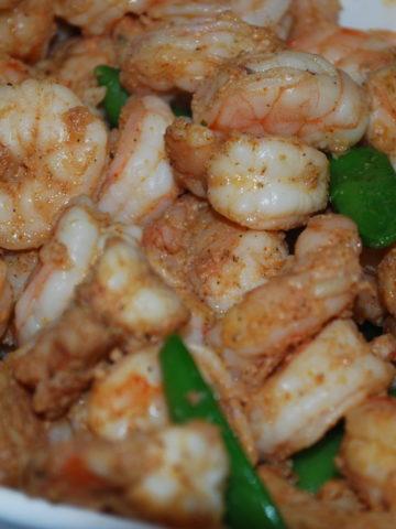 Shrimp with snow pea salad.