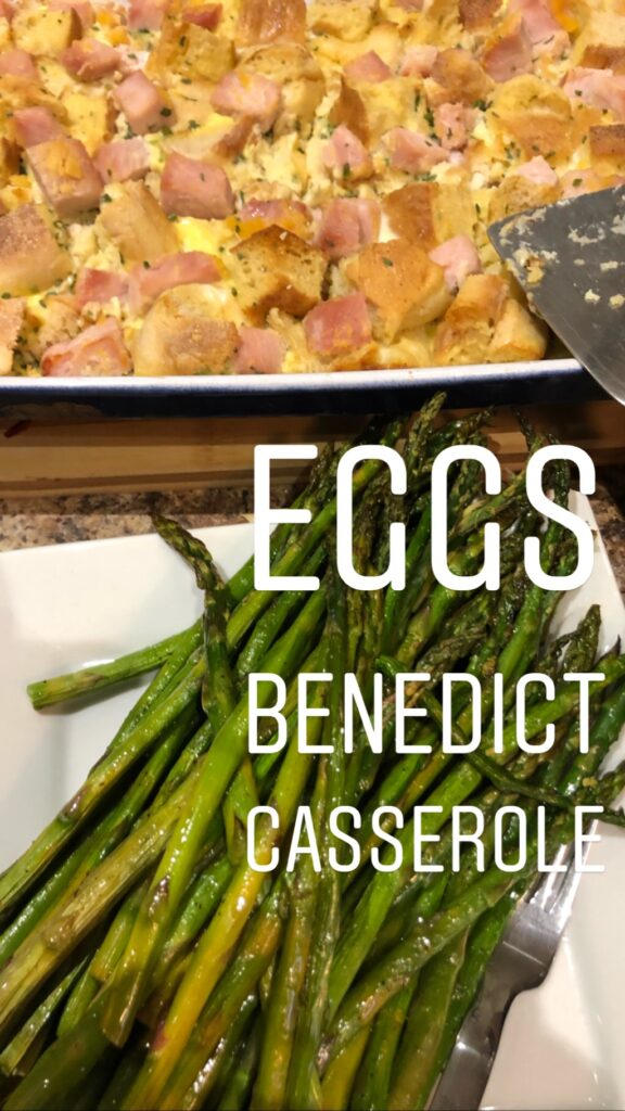 Eggs Benedict casserole in a white baking dish, and roasted asparagus on a white platter