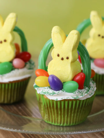 Yellow Peeps Bunny on top of cupcake with Jelly beans and a licorice used to make a basket handle