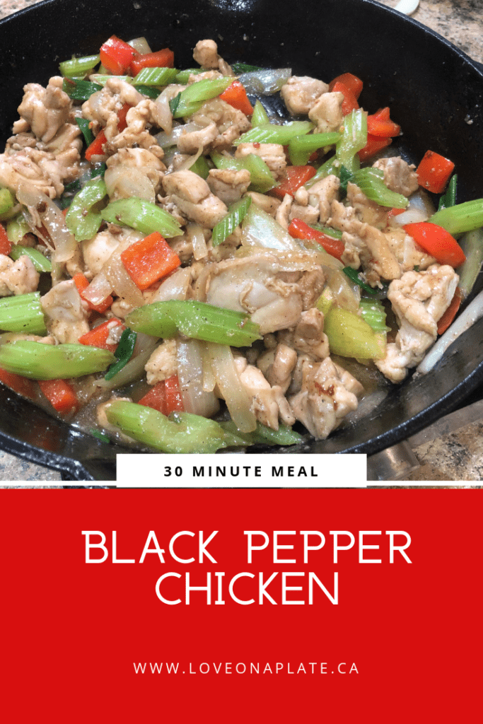 Cubes of chicken, celery, red pepper and onions in cast iron pan
