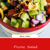 Summer fresh salad for a crowd with corn, beans, cucumber, red onion, chopped tomato and shredded cheese