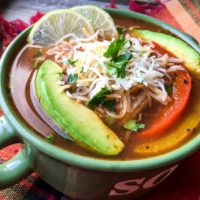 Slices of ripe avocado and melted shredded cheese top this delicious Chicken Fajita soup made in the Instant Pot in just 15 minutes