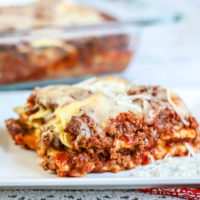 Layers of cheese ravioli, ground beef, marinara sauce and cheese baked in a casserole dish