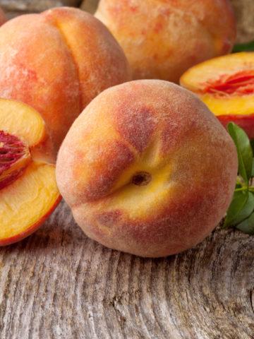 Fresh peaches on a wooden board