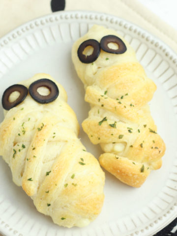 Cheese Stuffed Mummy Breadsticks with olive slices for eyes. A Halloween treat!