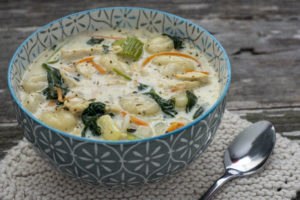 Creamy chicken and gnocchi soup in a large bowl served for dinner