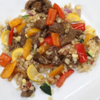 Keto friendly beef and pepper stir fry with cauliflower fried rice