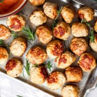 Baked chicken meatballs with marinara sauce for dipping