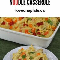 Cheesy Chicken Noodle Casserole baked in a baking dish and served up on a white plate