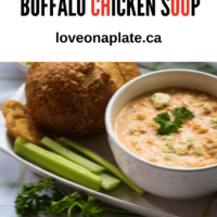 Buffal Chicken Soup topped with blue cheese crumbles with bread and celery sticks