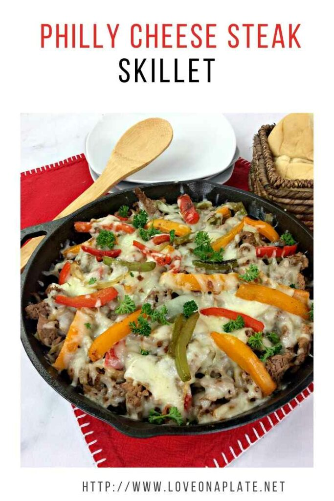 Philly Cheese Steak and peppers in a cast iron skillet