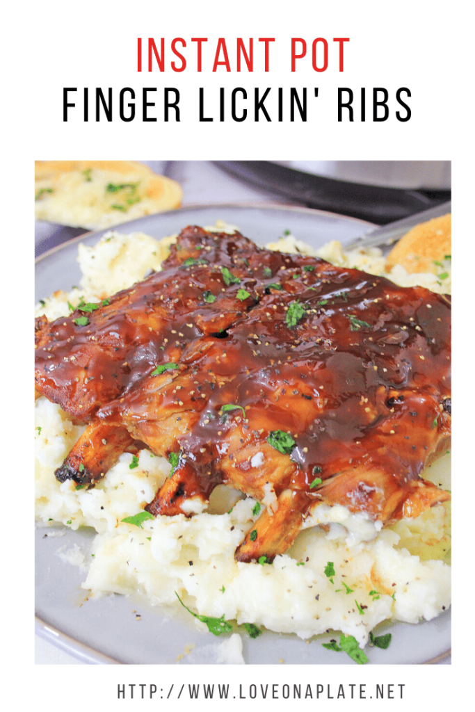 Instant Pot spare ribs with bbq sauce on top of garlic mashed potatoes on a while plate