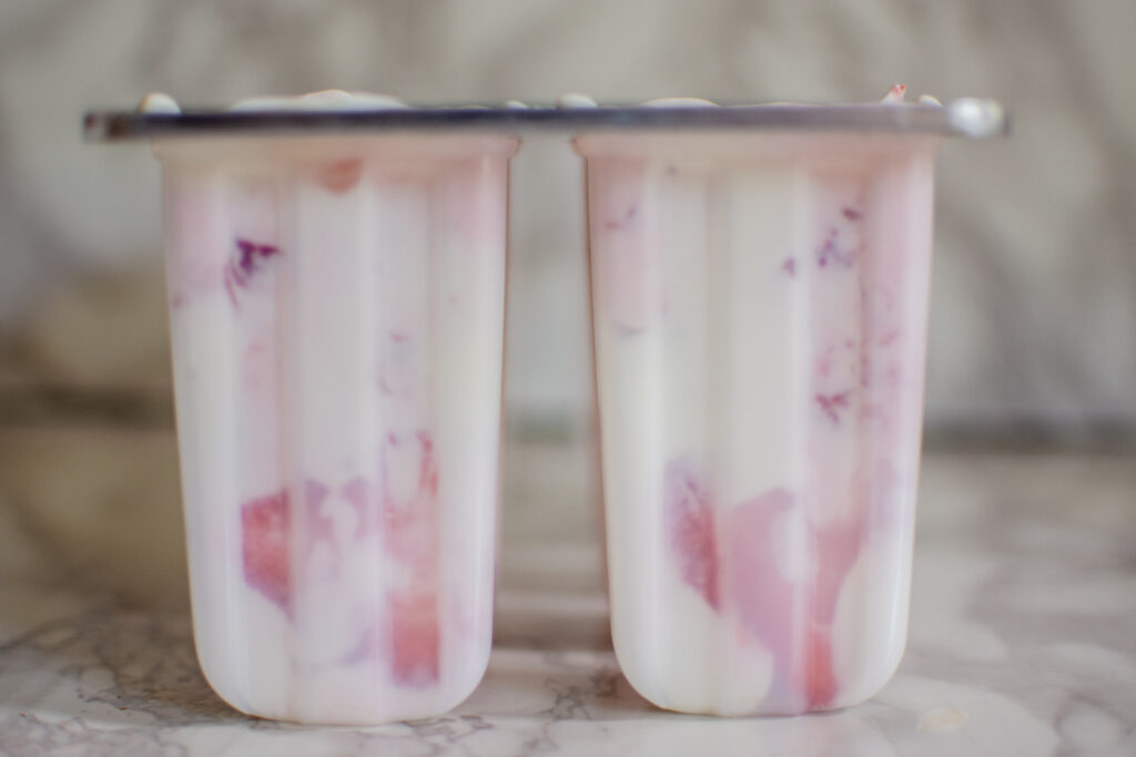Greek Yogurt popsicles studded with fresh strawberry slices.