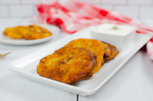 Mashed potatoes with cheese, shaped into patties and pan fried until crisp.