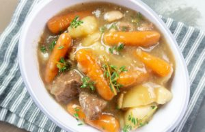 Cooked beef cubes, baby carrots, large pieces of potatoes, in a beef broth that is cooked with Guinness beer, thyme and bay leaves in the Instant Pot