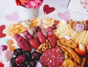 Fruit kebabs, Strawberries, Raspberries, and Mandarins shaped into cupids arrows.