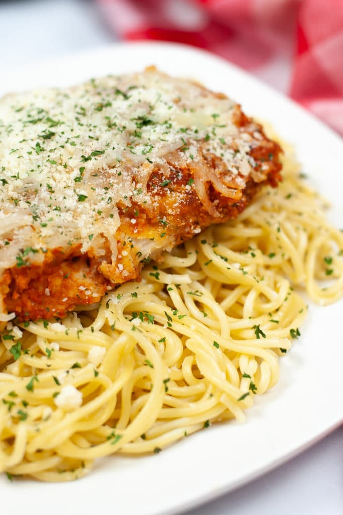 Crispy breaded chicken breast topped with marinara sauce and Mozzarella cheese cooked in an Air Fryer. Served on top of cooked Spaghetti noodles