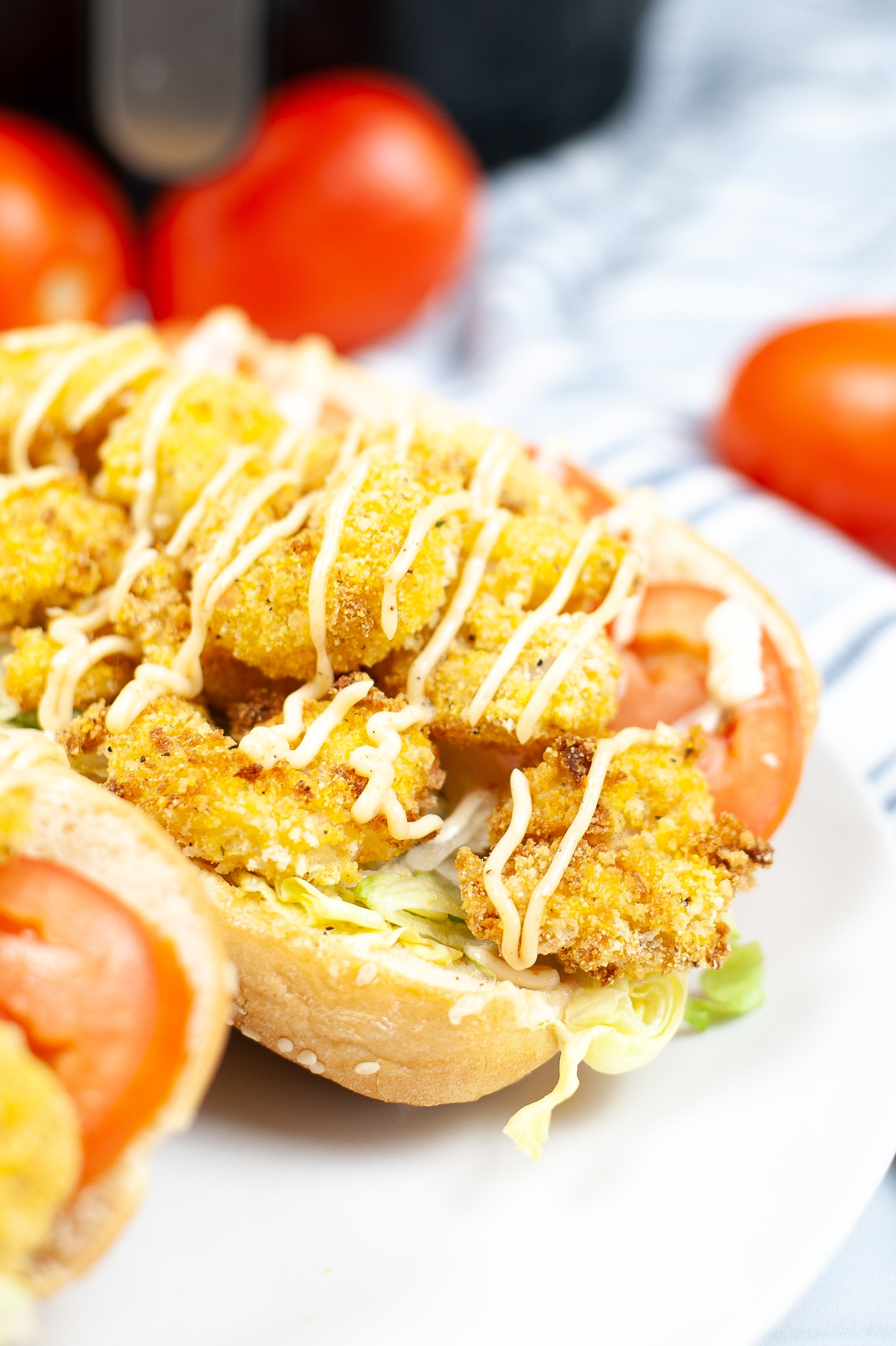 cornmeal crusted shrimp air fried, stacked on a hoagie bun with lettuce, tomato and mayonnaise